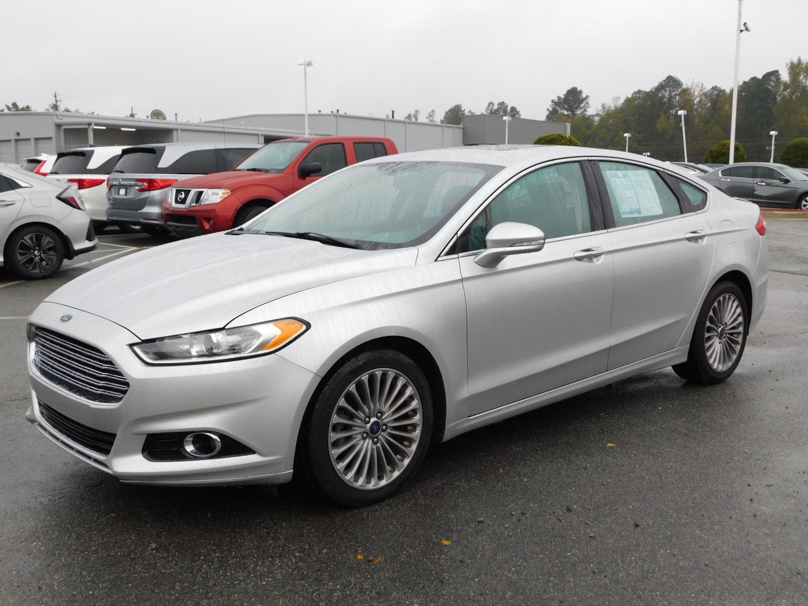 Pre Owned 2014 Ford Fusion Titanium 4dr Car in Milledgeville FX8359
